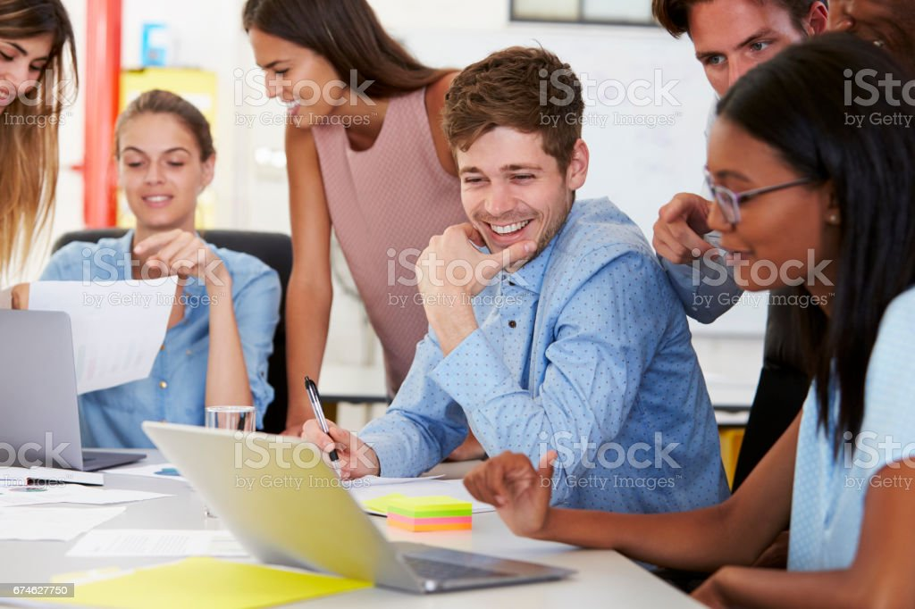 Colleagues working together in a busy office, close up stock photo