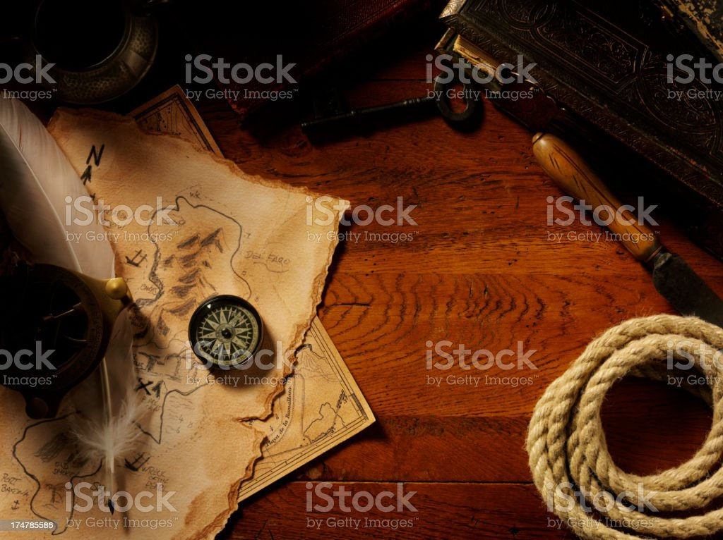 Collectables and an Oak Table with Treasure Maps royalty-free stock photo