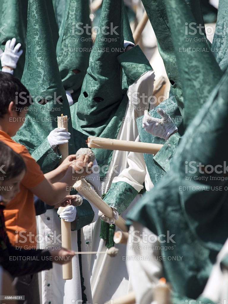 Collecting Candle Wax from the Nazarenos stock photo