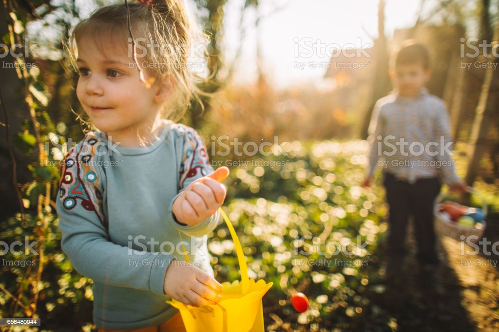 Collecting Easter eggs stock photo