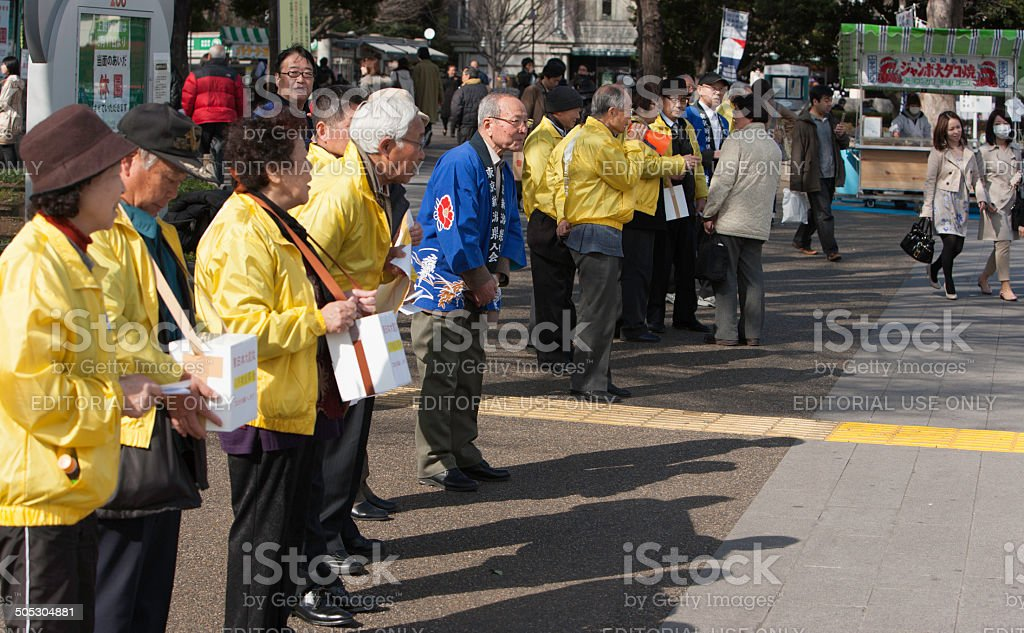 Collecting for Fukushima Recovery stock photo
