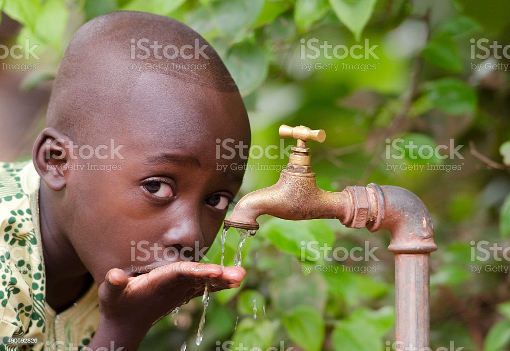 Collecting Water for African Children Project Fresh stock photo