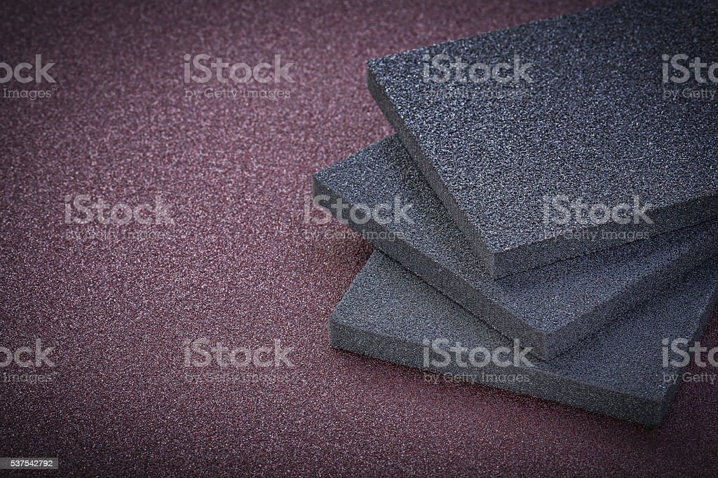 Collection of abrasive sponges on emery paper copy space stock photo