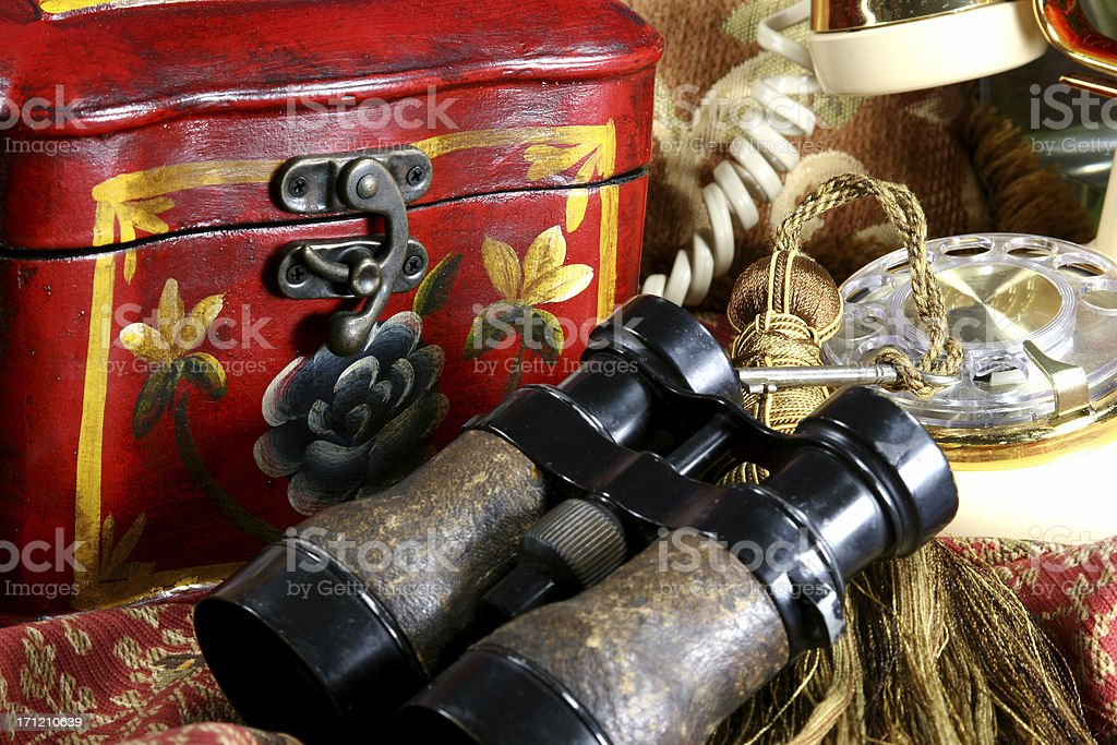 Collection of antique box, telephone, binoculars and old key royalty-free stock photo