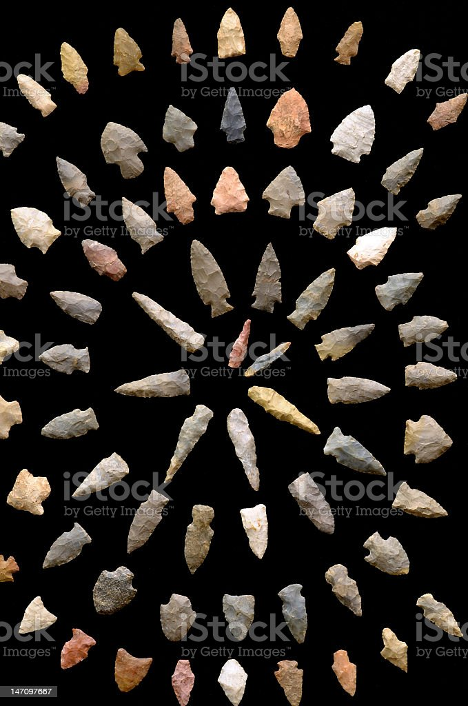 Collection of arrowheads in spiral formation  stock photo