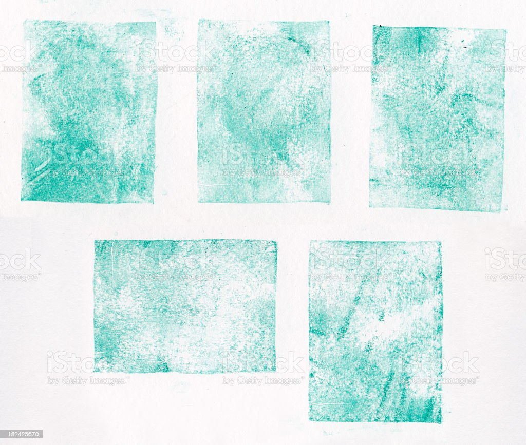 A collection of blue letterpress printed square shapes stock photo