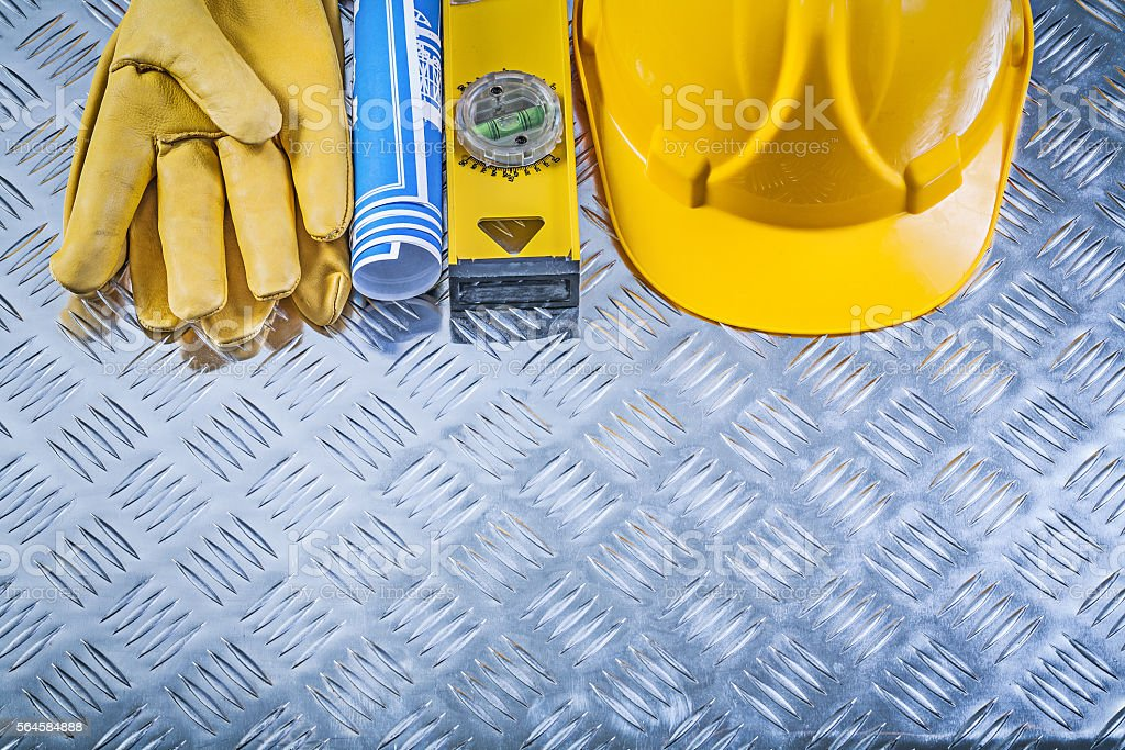 Collection of blue rolled blueprints building helmet safety glov stock photo