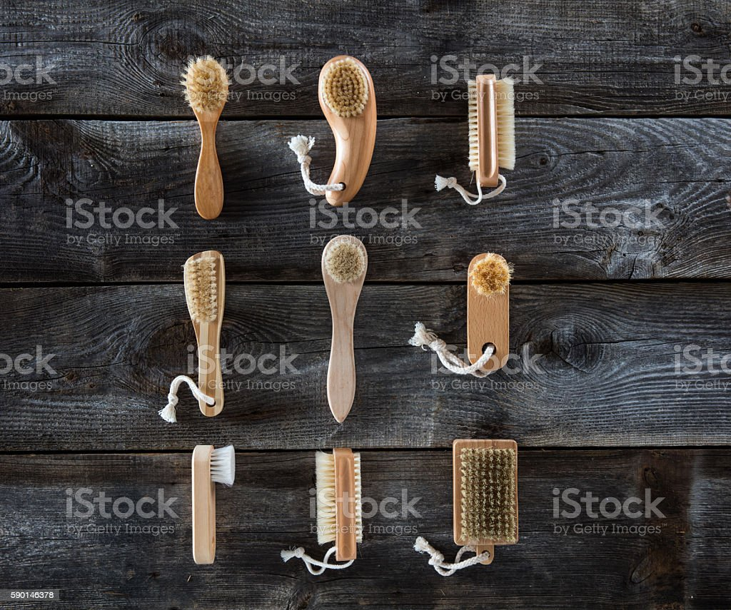 collection of body brushes on old wood background, top view stock photo