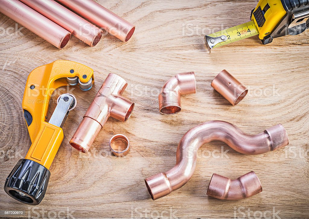 Collection of brass water pipe cutter fixtures tape measure on stock photo