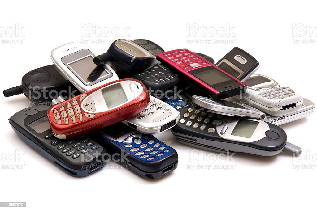 A collection of cellphones gathered in a pile  stock photo