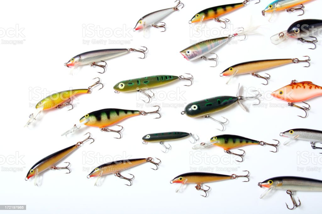 Collection of colorful fishing lures with hooks on white stock photo
