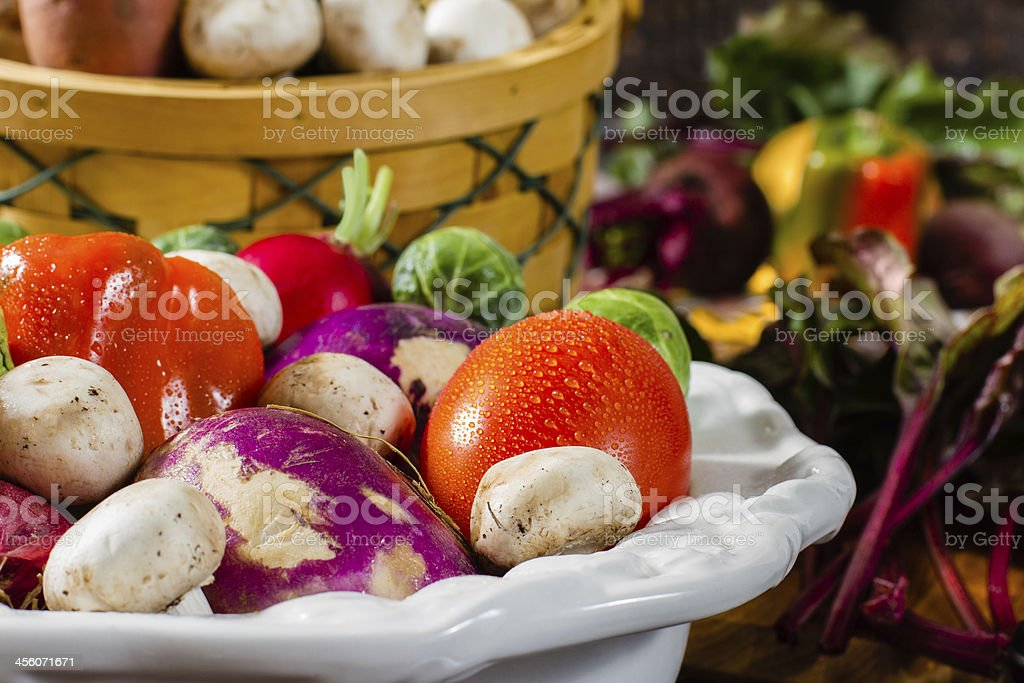 Collection of colorful, fresh vegetables in a decorative bowl. stock photo