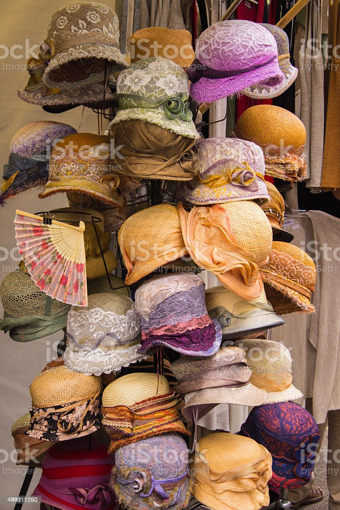 Collection of colorful hats on stall at the bazaar stock photo
