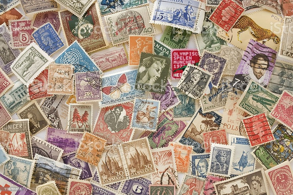 Collection of colorful old world stamps stock photo