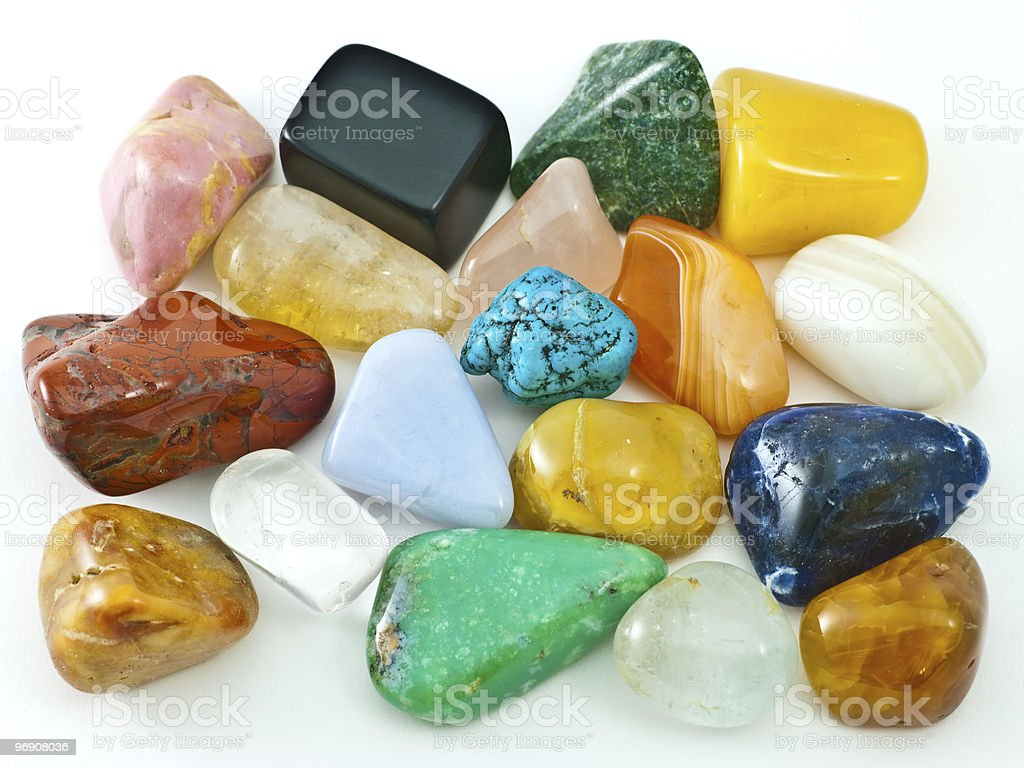 Collection of colorful polished semiprecious gemstones on white royalty-free stock photo