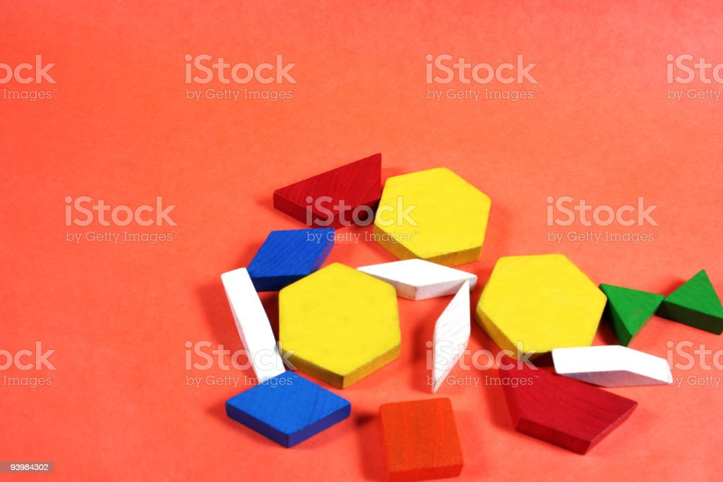 Collection of colorful shapes on an orange background. royalty-free stock photo