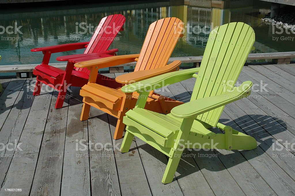 Collection of Colourful Adirondack Chairs stock photo