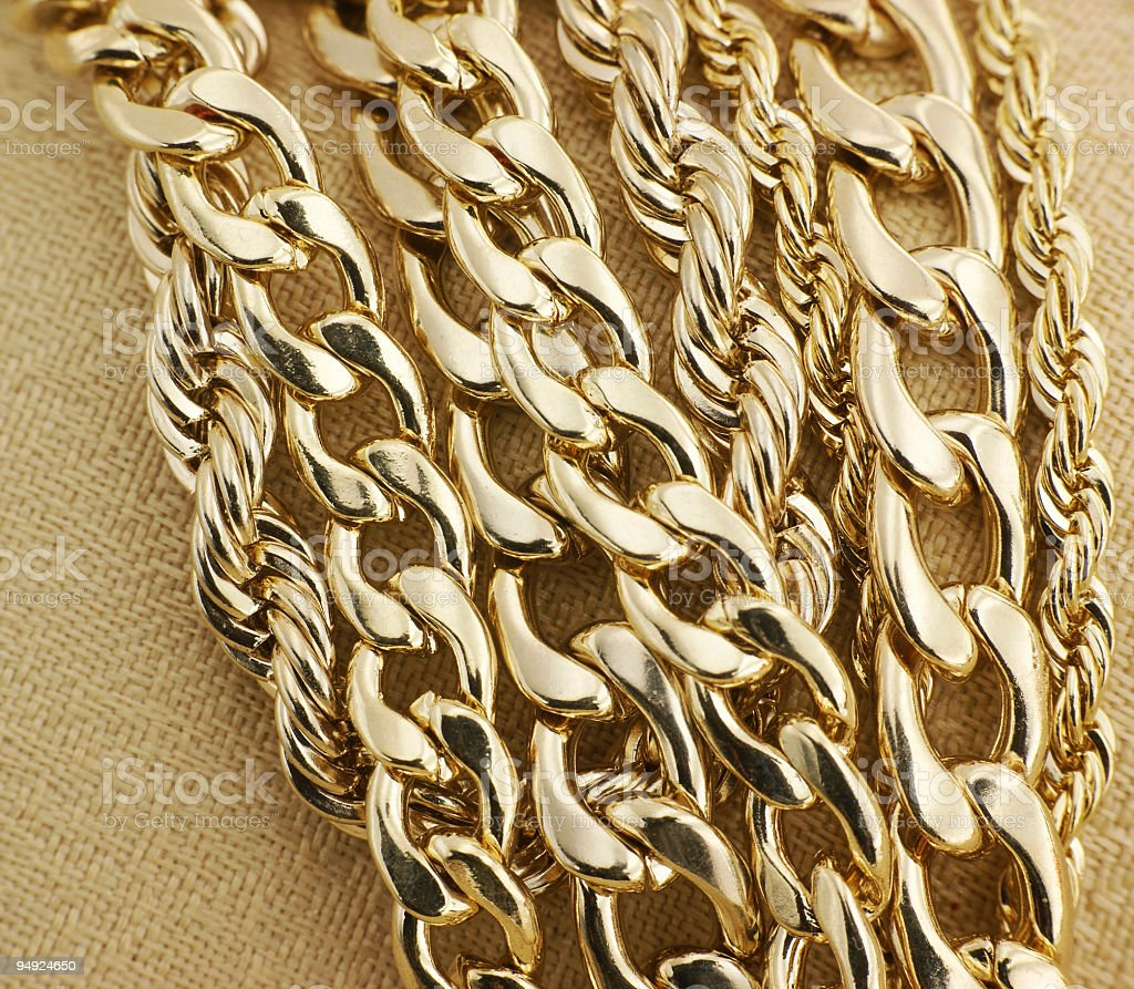 Collection of different types of gold chains stock photo