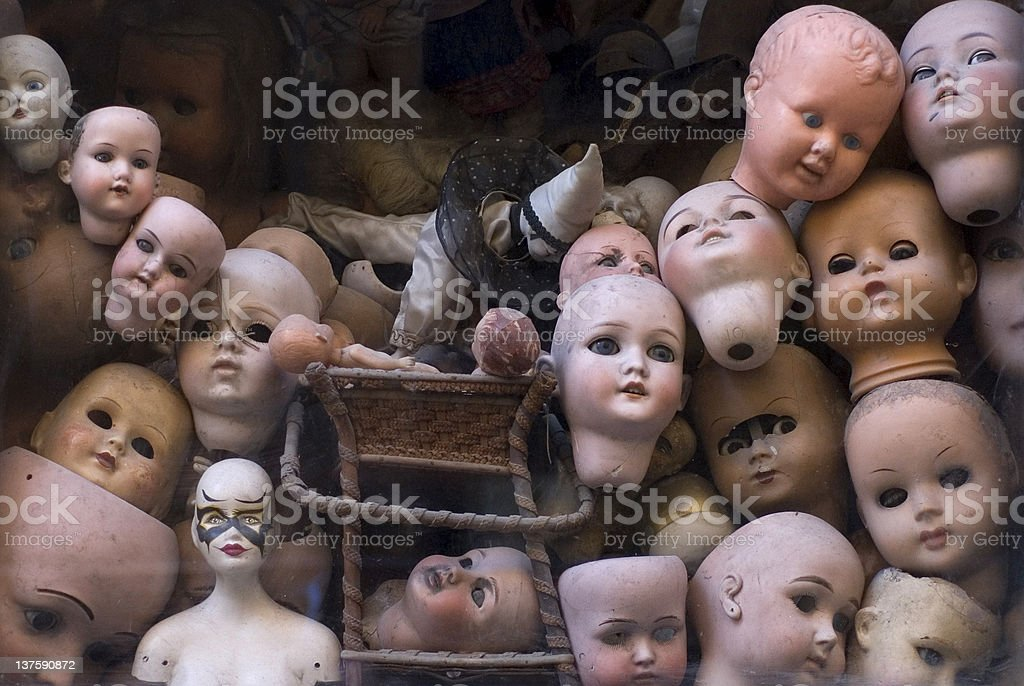 Collection of doll heads in a room stock photo