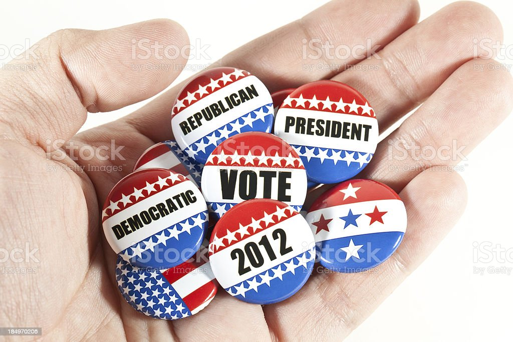 collection of election pins on hand royalty-free stock photo