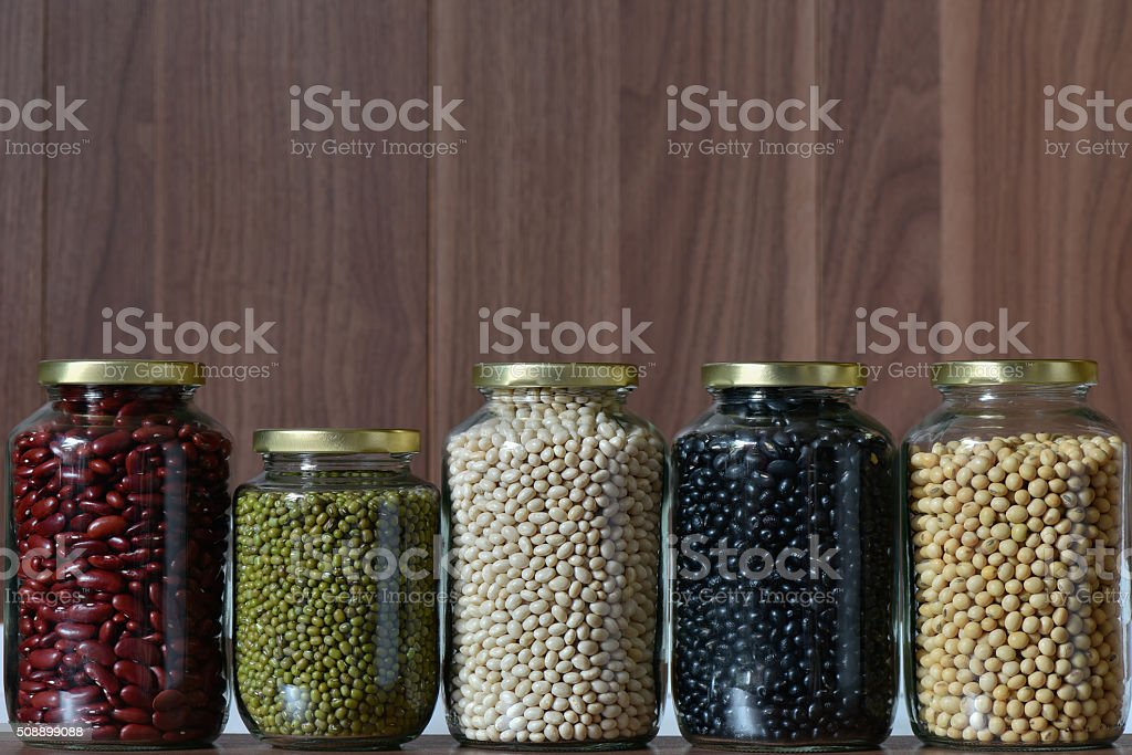 Collection of Five colour Lentils in a class jar stock photo
