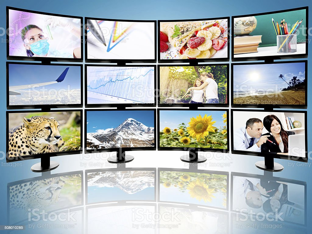 Collection of flat screen televisions broadcasting different cable channels stock photo