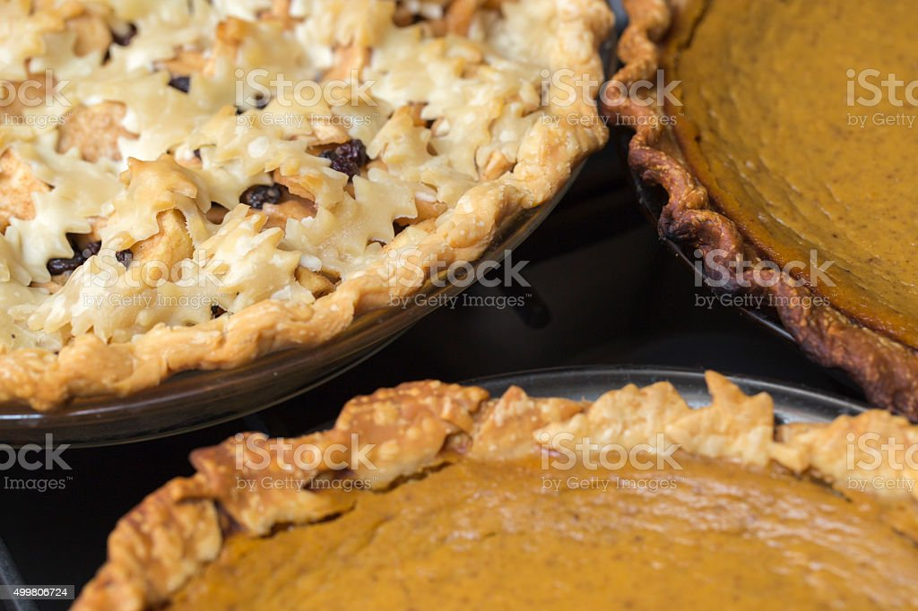 Collection of fresh apple and pumpkin pies close together stock photo