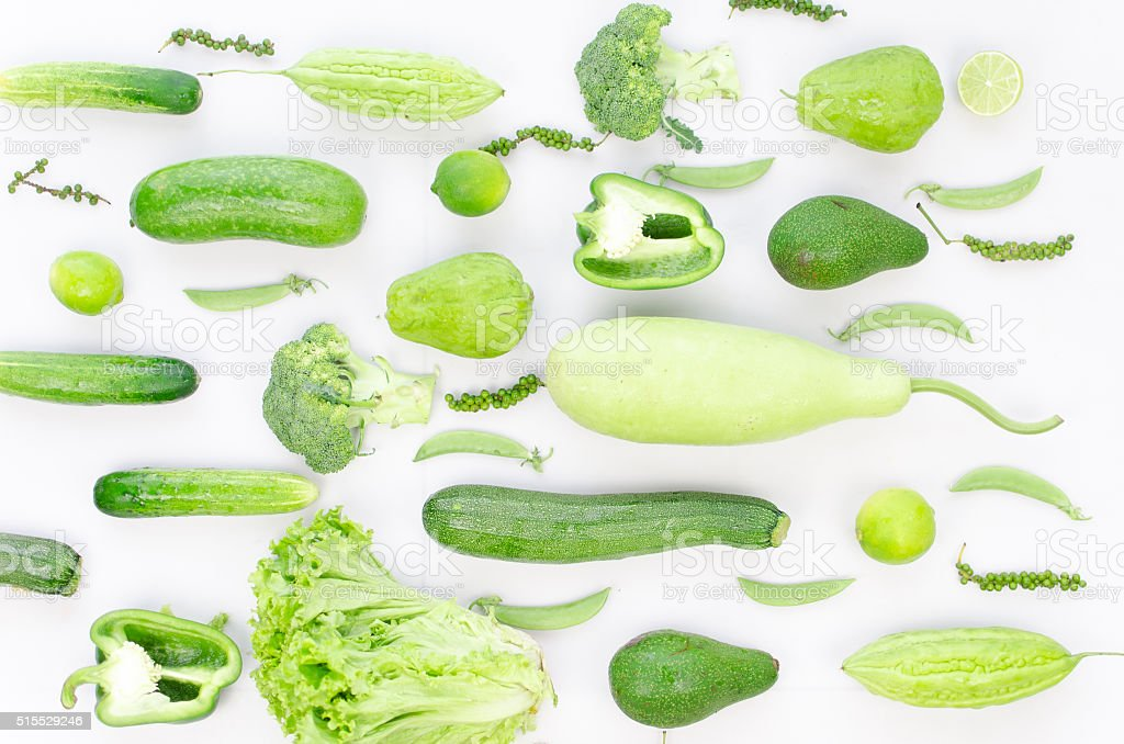 Collection of fresh green vegetables on white background stock photo