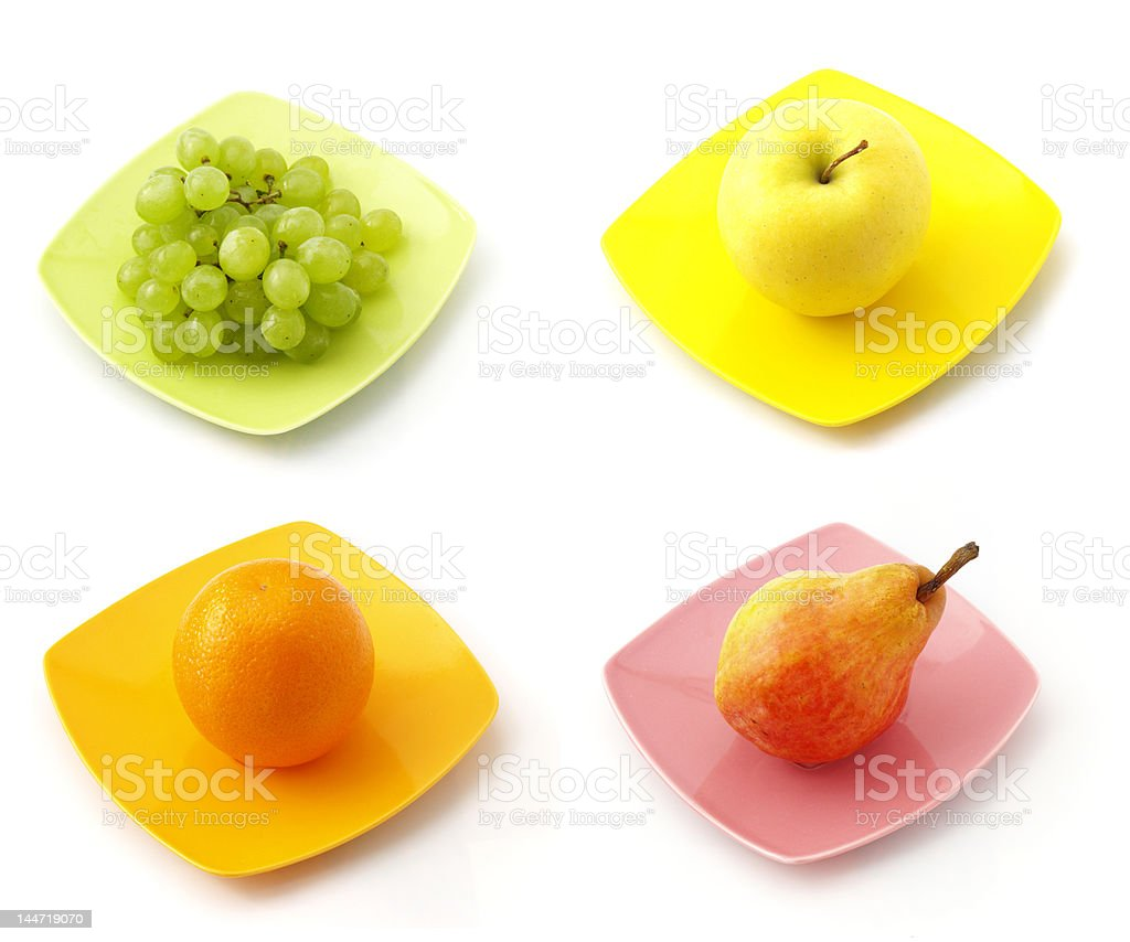 collection of fruits on the dishes royalty-free stock photo
