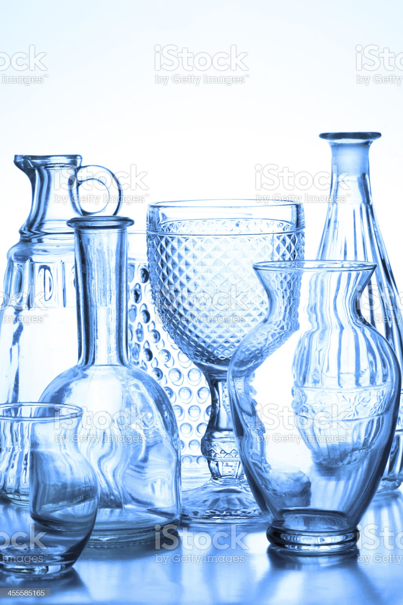Collection of glass vases backlit with blue tone. royalty-free stock photo