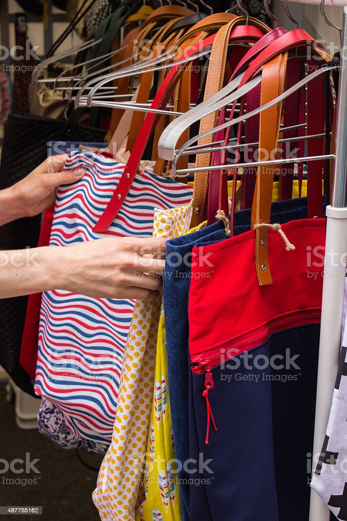 Collection of handbags on stall at the bazaar stock photo