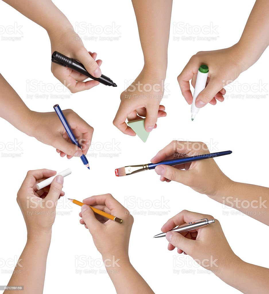 Collection of hands holding different stationary objects stock photo