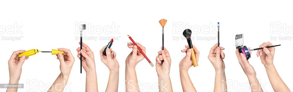 collection of hands holding tools for makeup stock photo
