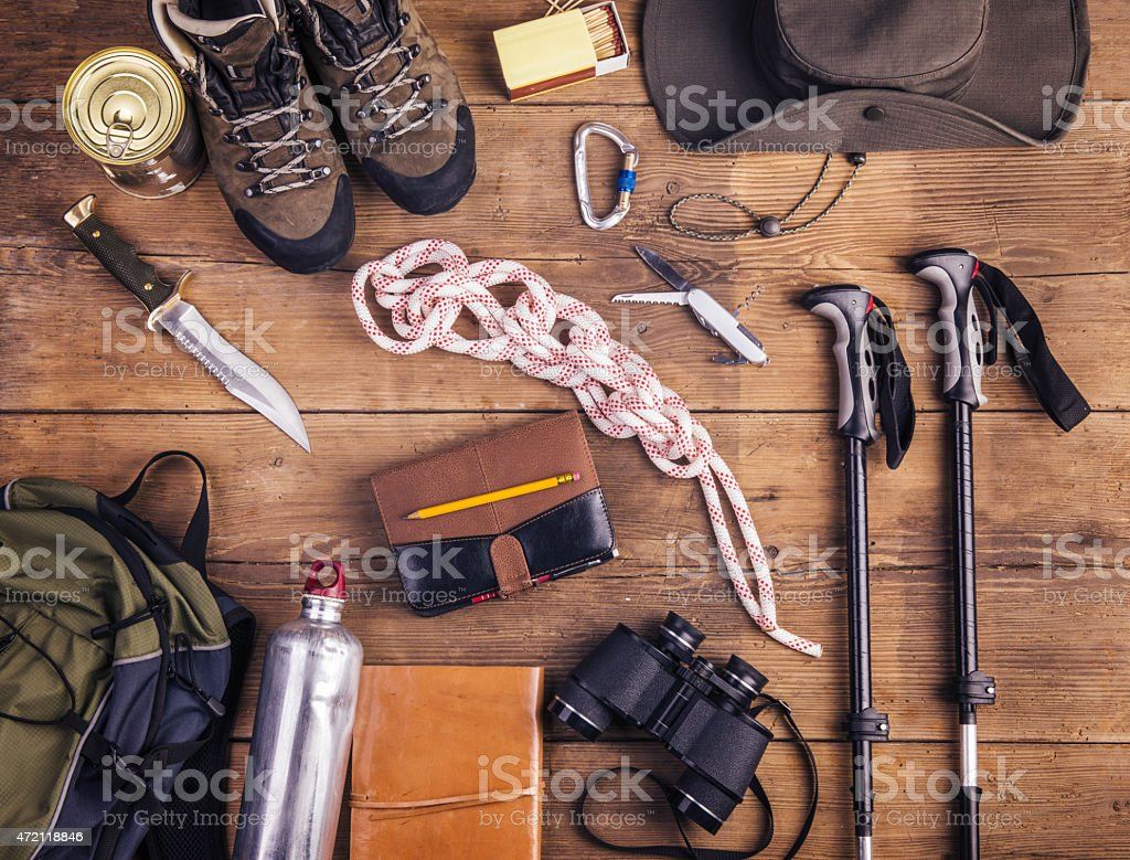 Collection of hiking equipment on wooden floor stock photo