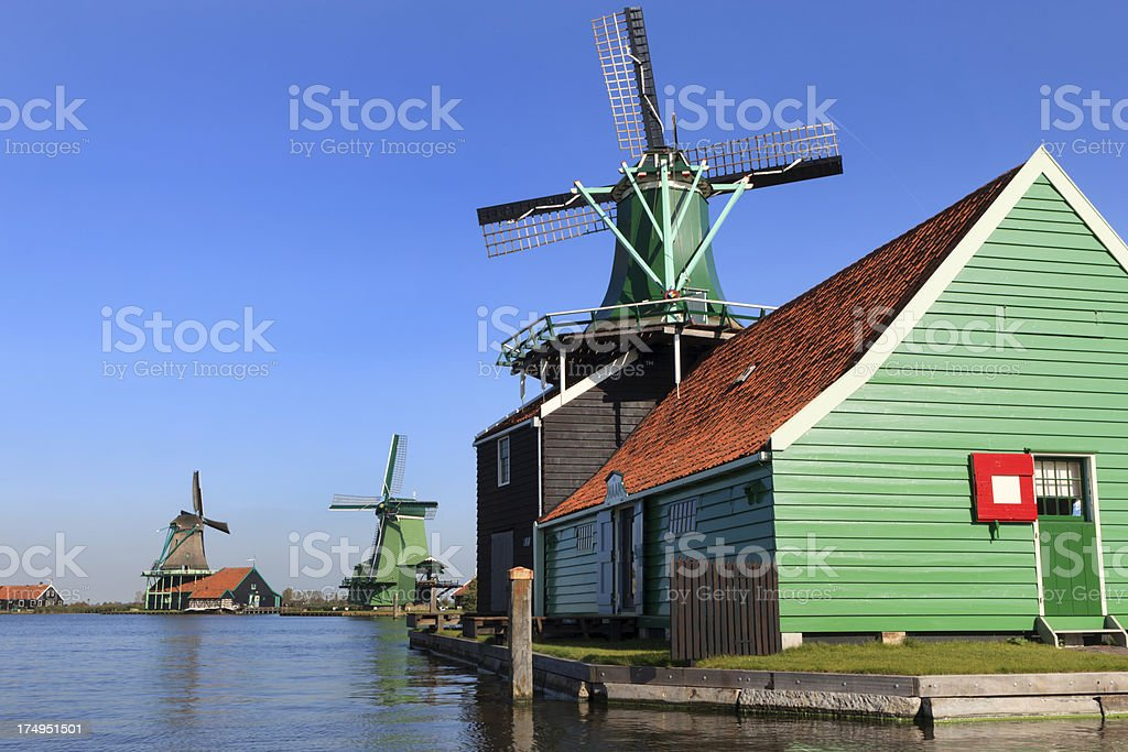 collection of historic windmills in a row at Zaanse Schans royalty-free stock photo