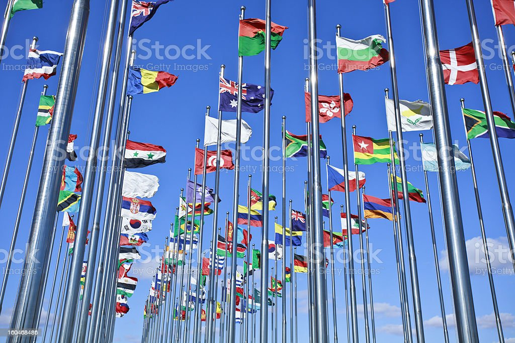 Collection of international flags against a blue sky royalty-free stock photo