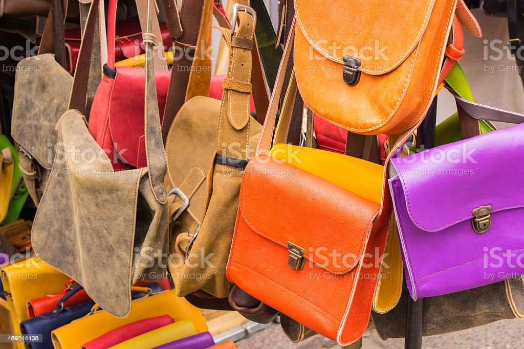 Collection of leather handbags on stall at the bazaar stock photo