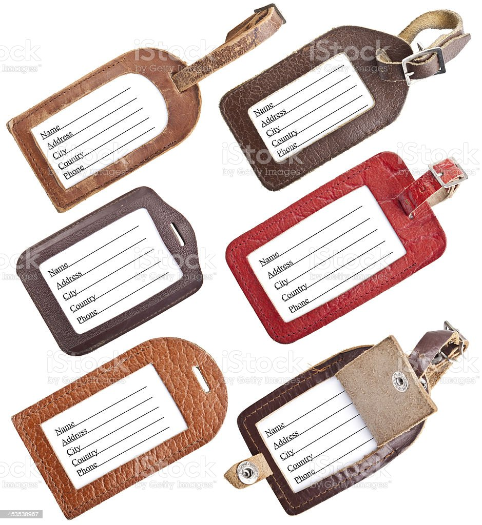 Collection of leather luggage tags isolated on white stock photo