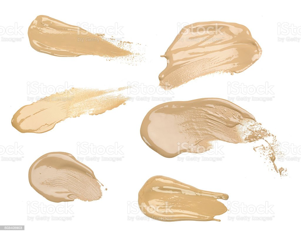 Collection of make up liquid foundation strokes on white stock photo