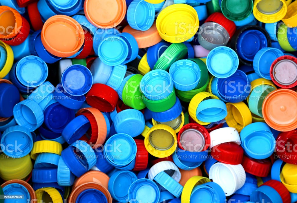 collection of many plastic caps for recycling stock photo