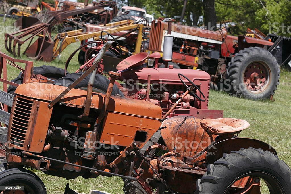 Collection of obsolete farm tractors and equipment royalty-free stock photo