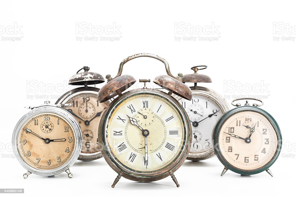Collection of old alarm clocks stock photo