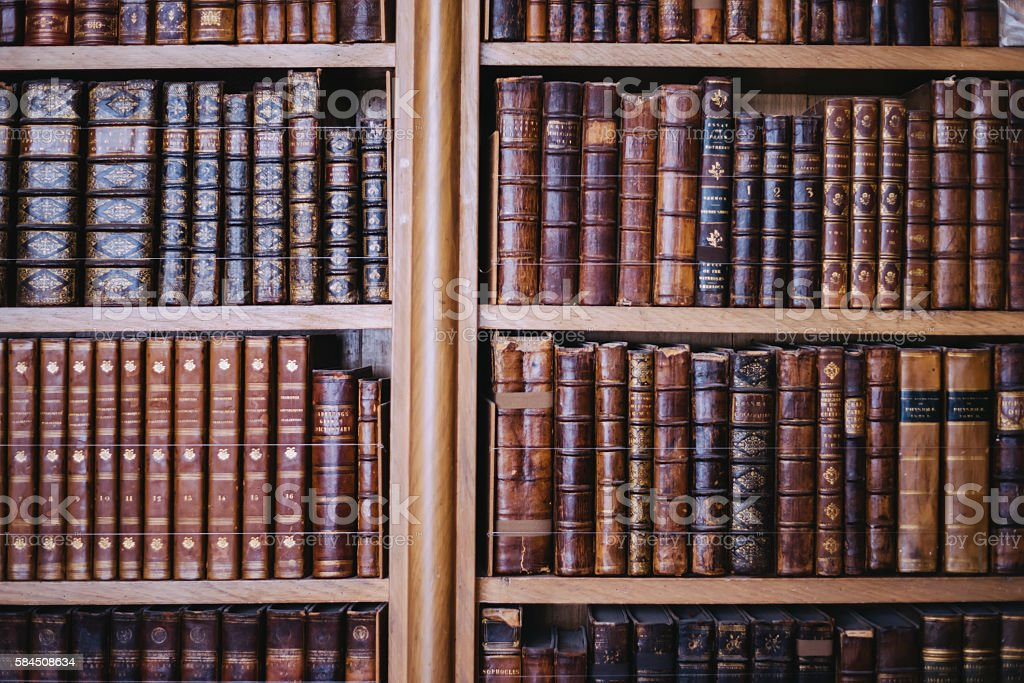 Collection of old books;  carefully arranged bookcase stock photo