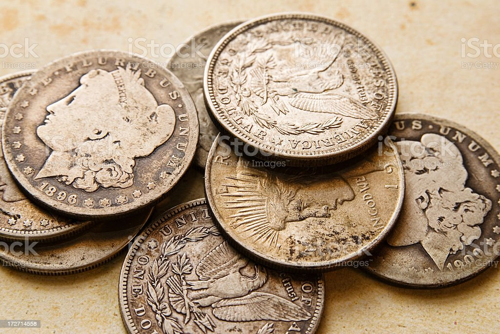 Collection of old metal coins with heads side up stock photo
