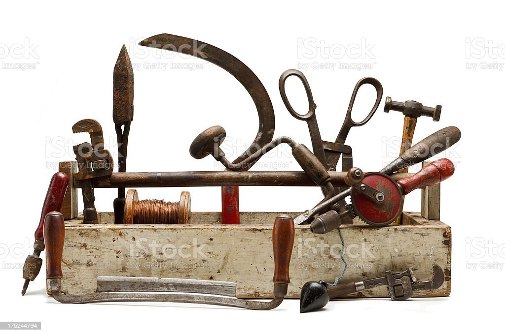 Collection of old tools around and in a toolbox. royalty-free stock photo