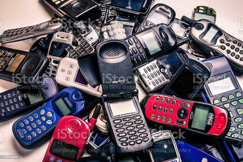 collection of old used mobile phones stock photo