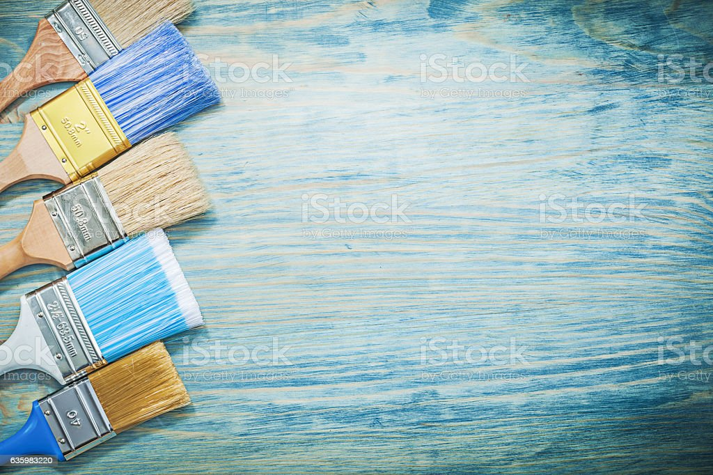 Collection of paintbrushes on wooden board copy space constructi stock photo