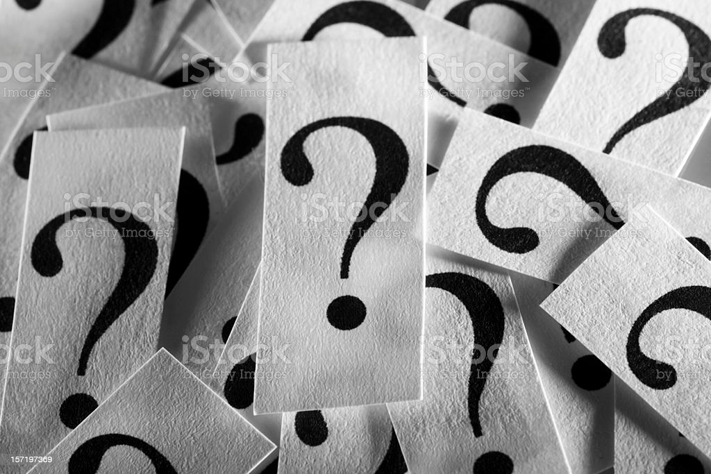 A collection of paper question marks stock photo
