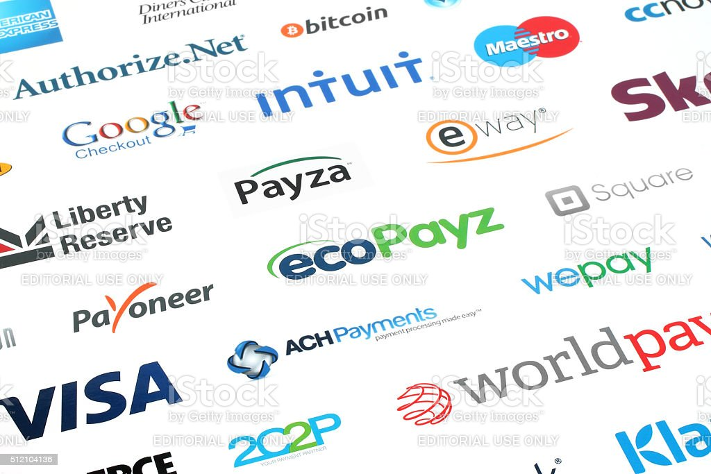 Collection of popular payment system logos printed on white paper stock photo