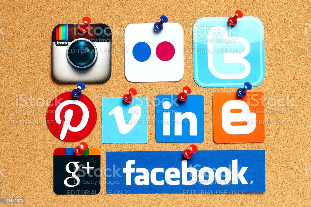 Collection of popular social media logos on cork background stock photo